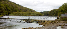Lopwell Dam, A Weir On The River Tavy, An Access Road Crosses Below The Dam, Devon, England, UK.