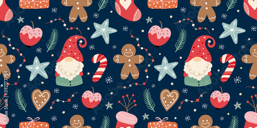 Obraz Christmas seamless pattern with gnomes, gingerbread, candies and decoration, winter seasonal design - fototapety do salonu