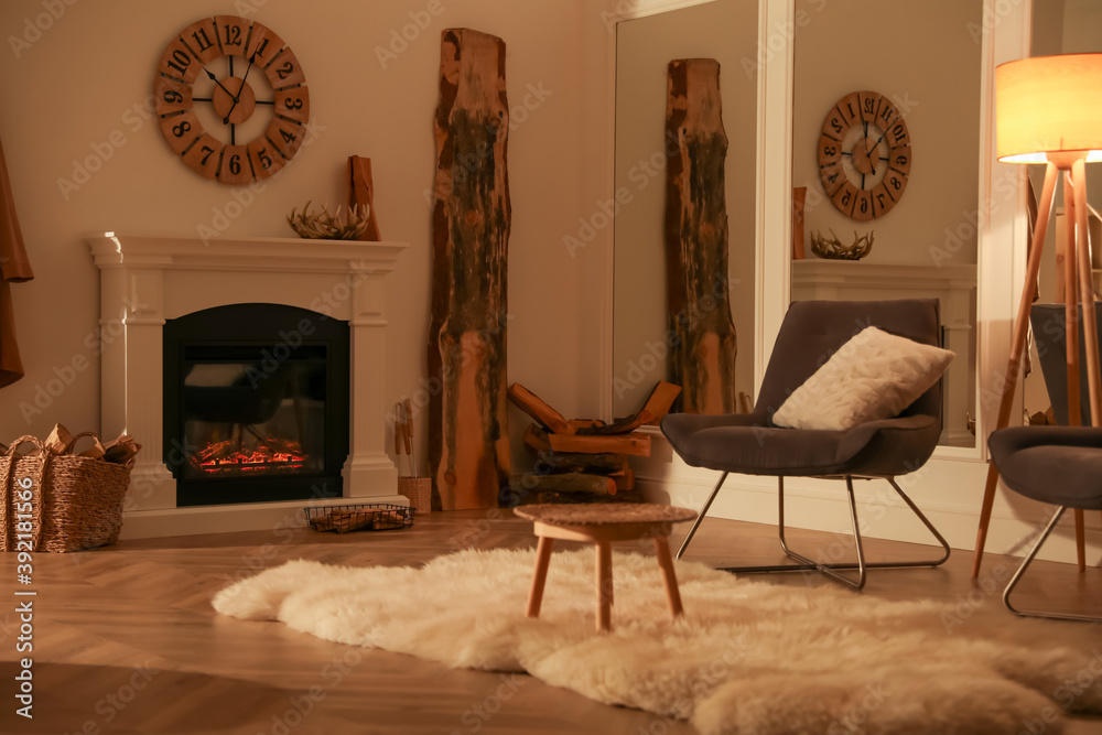 Fototapeta Beautiful view of cozy living room interior with fireplace