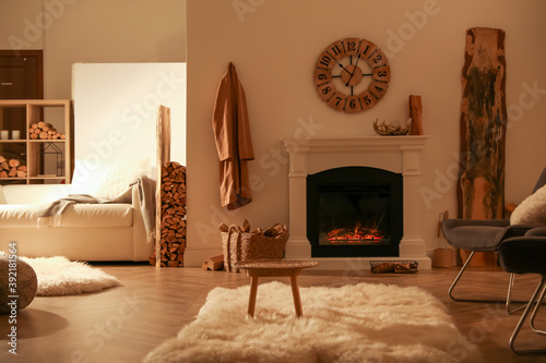 Obraz Beautiful view of cozy living room interior with fireplace - fototapety do salonu