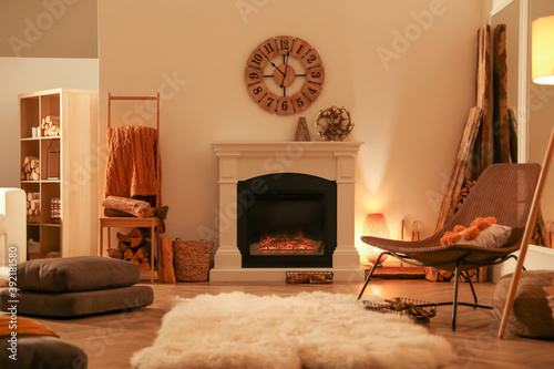 Fotografie, Obraz Beautiful view of cozy living room interior with fireplace