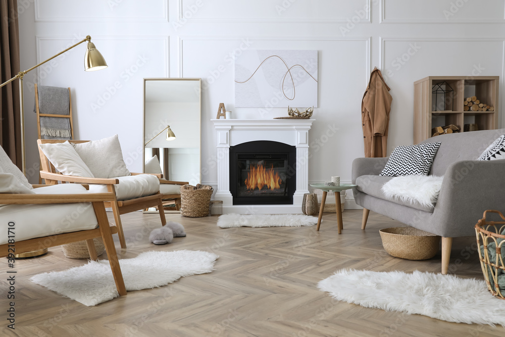 Fototapeta Beautiful living room interior with fireplace and armchairs