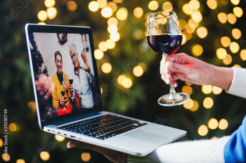 Obraz na plátně Mexican family toast on Christmas videocall online through laptop in Mexico