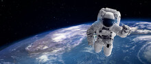 Astronaut In Outer Space Over Earth And Star For Background.  Elements Of This Image Furnished By NASA