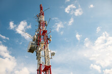 Low Angle Shot Of A Telecommunications Tower Under A Bright Sky