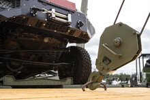 Loading A Military Vehicle Using A Truck Crane. Selective Focus. Close-up