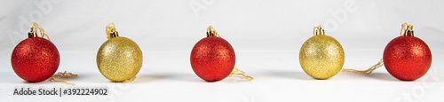 Fototapeta Christmas balls in a row Isolated. Collection of Xmas baubles on white background.  obraz