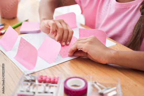 Girl using pink stickers