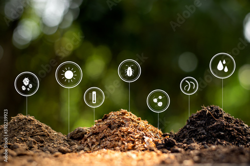 Soil, manure and sawdust are stacked in the middle of the green nature.