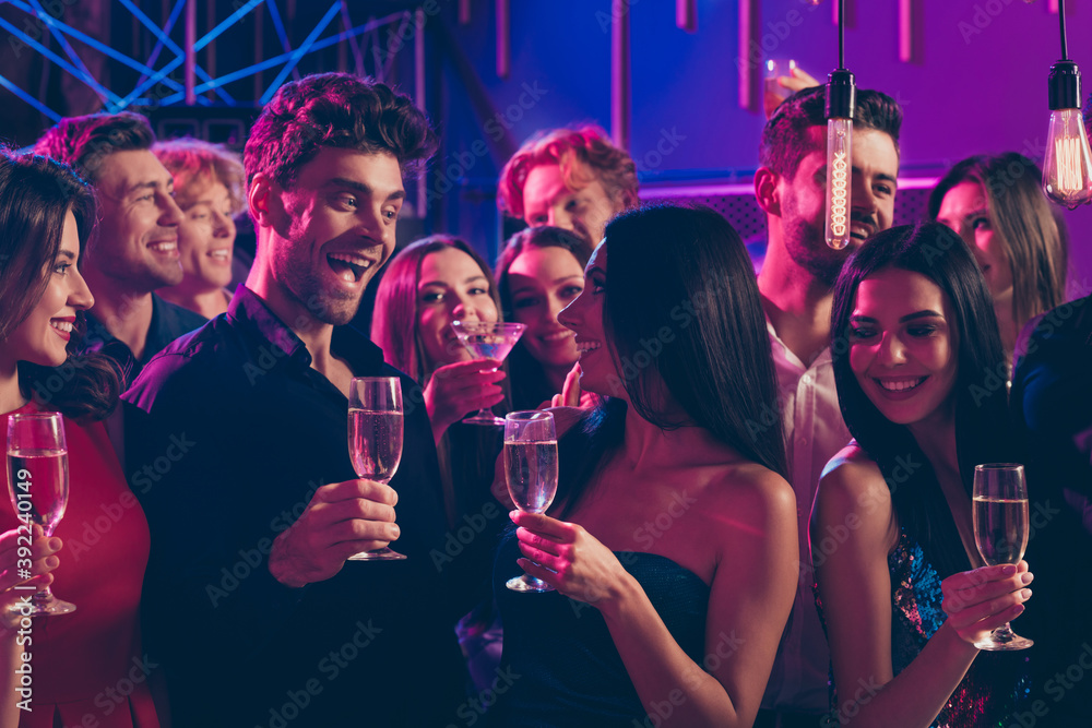 Fototapeta Photo portrait of lovely couple looking at each other together holding champagne glasses speaking toast