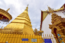 Golden Pagoda Of Wat Phra That Cho Hae In Phrae Province, Thailand