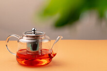 Glass Teapot With Black Tea On...