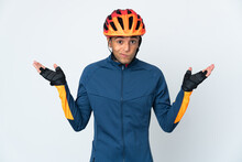 Young Cyclist Brazilian Man Isolated On White Background Having Doubts While Raising Hands