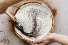 Woman Mixing Flour Into Browni...