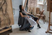 Beautiful Asian Woman Wearing Black And White Dress Posing In The Art Studio