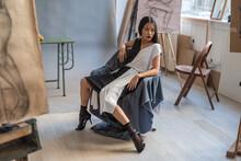 Fashionable Asian Woman Posing In The Art Studio