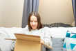 A disgruntled young woman is indignant at the received parcel, an angry one opens the box