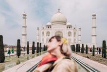 Woman In Front Of The Taj Mahal Wearing A Sari