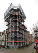Corner House With Scaffolds