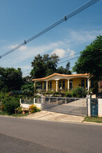 Gated Yellow Hispanic House