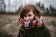 Young Woman In Coat And Scarf ...
