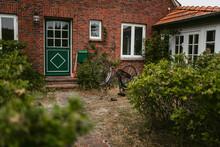 Bike On Yard Near Country House