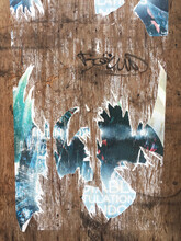 Wall With Torn Poster