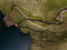 Aerial Landscape Of River Delta In Mountainous Terrain