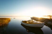 Modern Boat In Bay During Sunr...