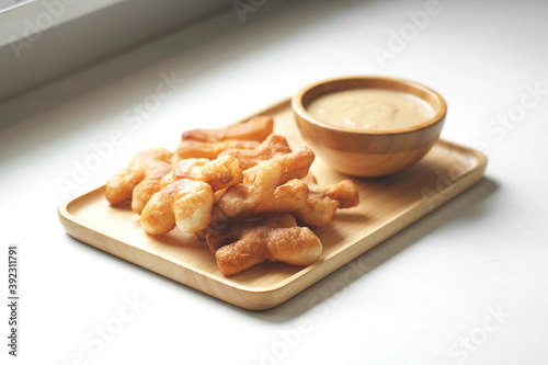 Fotomural Soft focus of Youtiao or Cakwe with milktea custard on brown wooden background