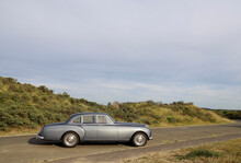 Classic Car Parked At Dunes