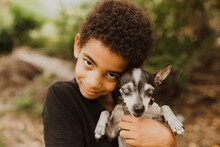 African-American Boy Taking His Old And Blind Chihuahua Dog