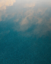 Sky Reflection From A Swimming Pool During Sunset On A Summer Evening.