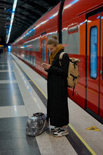 A Business Woman Responds To Emails And Messages In Messengers On Her Smartphone Before Taking The Train To The Airport In Moscow Russia
