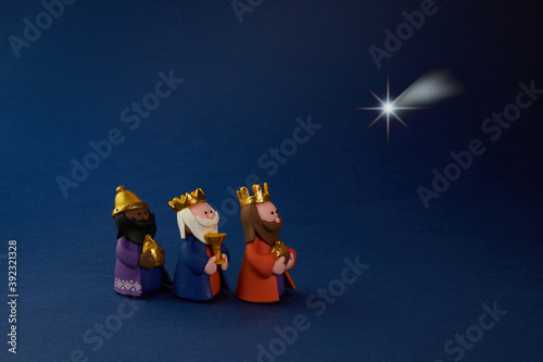 Fotografiet Happy Epiiphany day. Three wise man ant star on blue background.