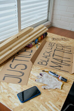 A Man Draws Posters With A Black Marker That Say Justice And Black Lives Matter