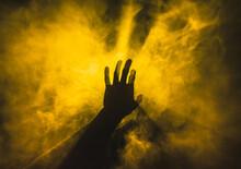 Hand Touches Yellow Smoke