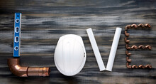 The Inscription LOVE  Made Up With Construction Tools. Valentines Composition With Plumbing Tools ,copy Space.