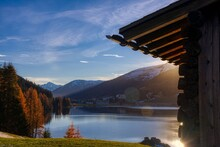 Lake And Mountains At Sunset Next To Chalet