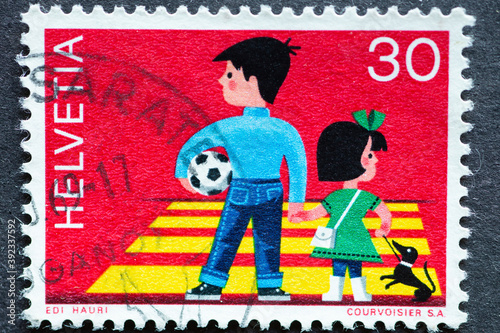 Fotografia, Obraz Switzerland - Circa 1969 : a postage stamp printed in the swiss showing a boy wi