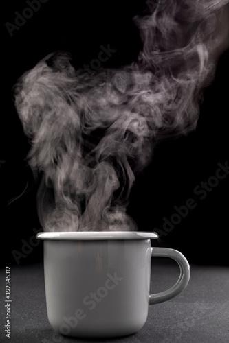 Steam hovering above a gray metal mug Fotobehang