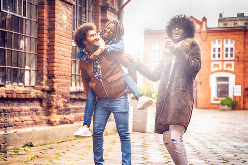Obraz Group of Afro friends having fun in the city and spending - fototapety do salonu