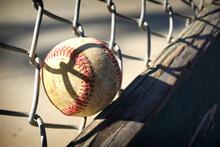 Baseball Stuck In Fence Of Ballpark