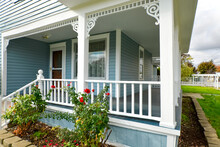 A Covered Wraparound Porch On ...