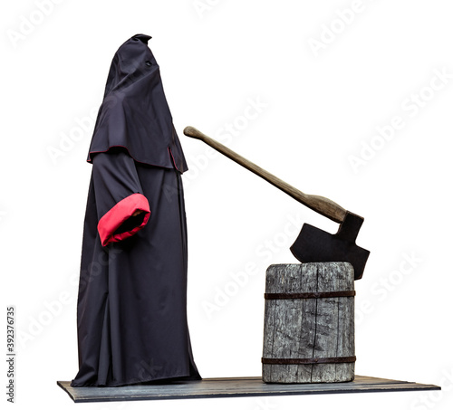 Medieval public executioner at place of separation of the head from the body beheading with an axe on a stump isolated on white.