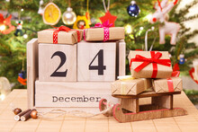 Date 24 December, Gifts With Sled And Christmas Tree With Decoration, Christmas Eve Time Concept