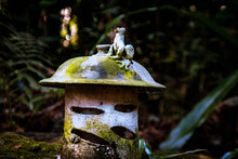 Moss Covered Light With Little Garden Creatures