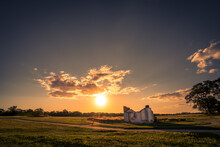 Country Scene With Lonely House With Clouds In Sunset