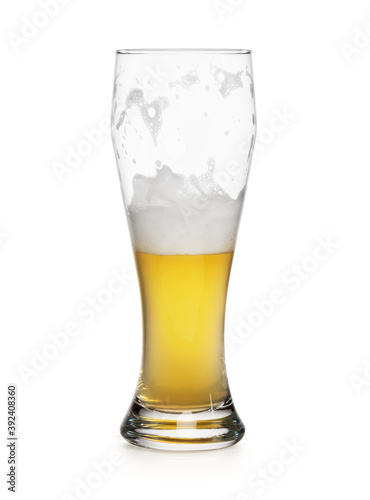 half empty glass of a light lager beer isolated Wallpaper Mural