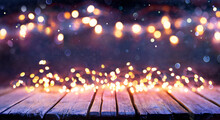 Abstract Christmas Background - Wooden Table With Defocused String Lights